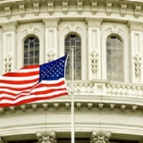 American flag in front of the Capitol Building